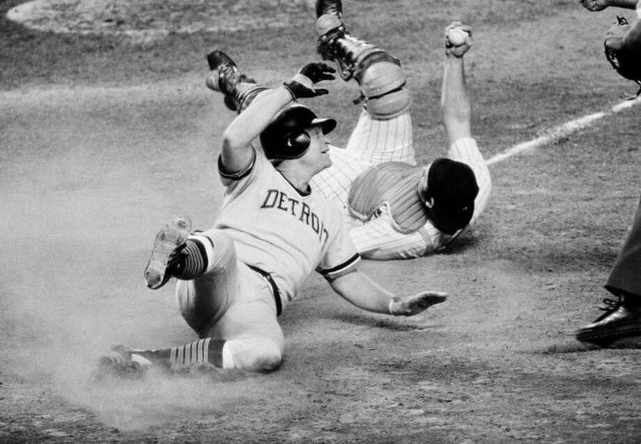 In this Sept. 5, 1978, file photo, Detroit Tigers' Rusty Staub looks towards the home plate umpire after being tagged out by New York Yankees catcher Thurman Munson on a sacrafice fly in the fourth inning of a baseball game in New York. (AP Photo/G. Paul Burnett, File)