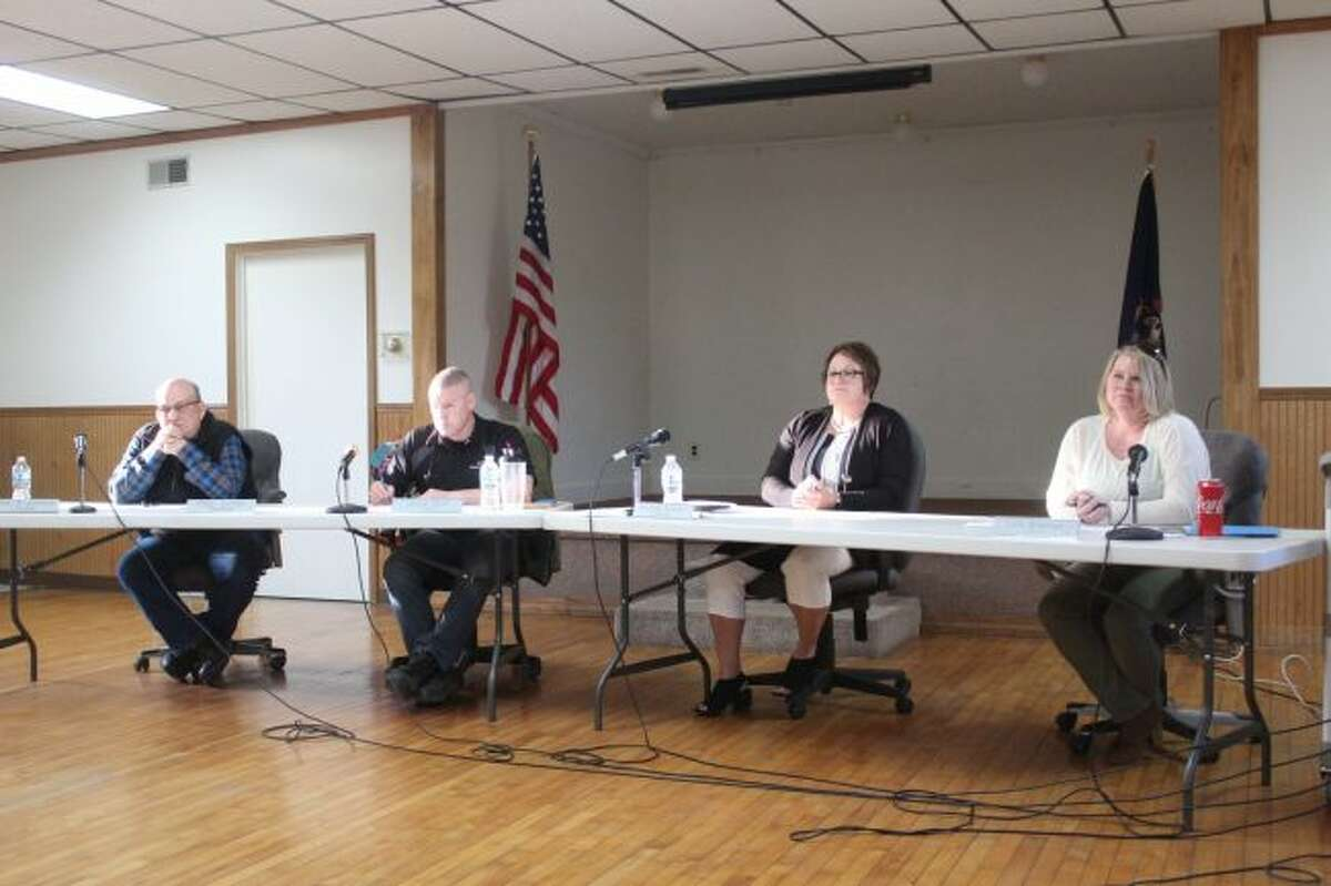 Mecosta Township Board of Trustees John Johnson and James Cain, Supervisor Michele Graham and Clerk Lois Brennan listen to public comment during a special meeting on March 28 to address the shared fire department with Austin Township. (Pioneer file photo)