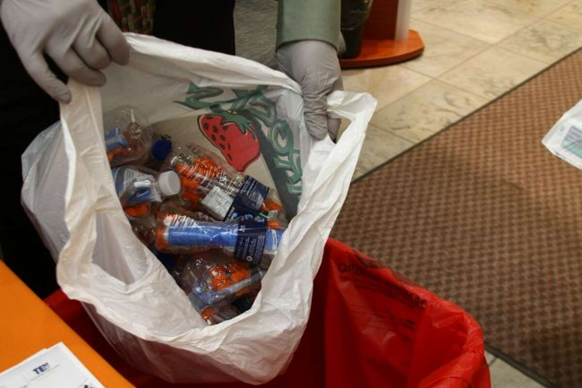 DISPOSAL: Old needles kept in water bottles were among the items dropped off during Thursday's medication and needle take-back event at Spectrum Health Big Rapids Hospital.