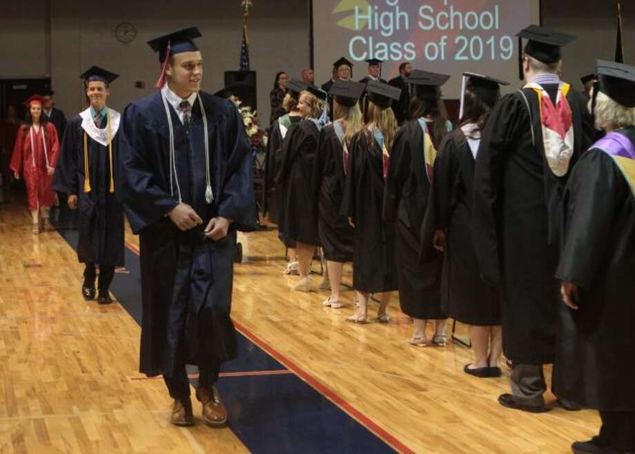 Students of the Big Rapids High School senior class made their way into the high school gym to participate in the graduation ceremonies Sunday afternoon. (Pioneer photos/Taylor Fussman)