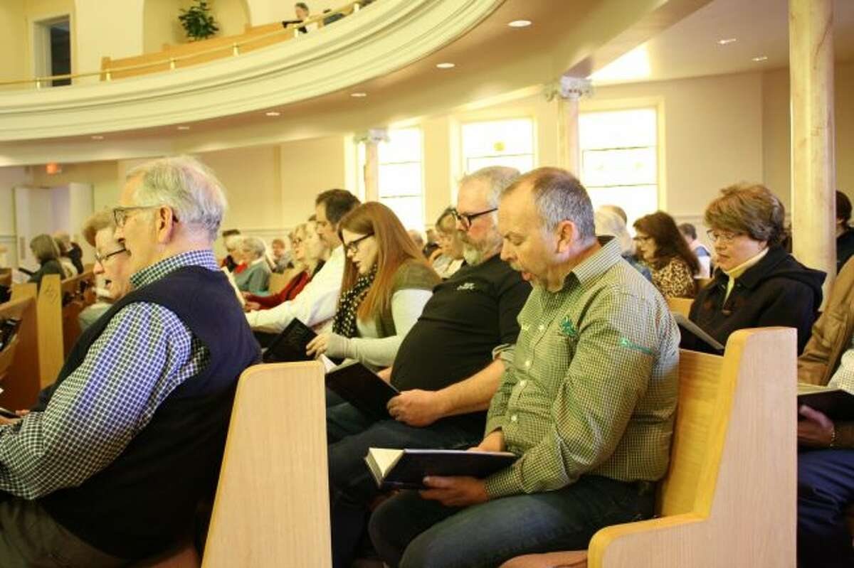 Local residents sing a hymn together during the community Good Friday service at Big Rapids First United Methodist Church. The service was a joint worship, led by pastors of several area churches. (Pioneer photo/Candy Allan)