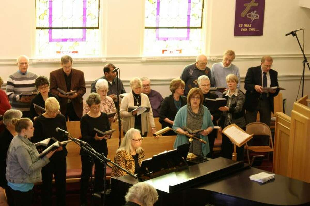 The community choir sang hymns with the combined congregation members during the Ecumenical Good Friday service. The worship service brought together the pastors and congregations of several area churches. (Pioneer photo/Candy Allan)