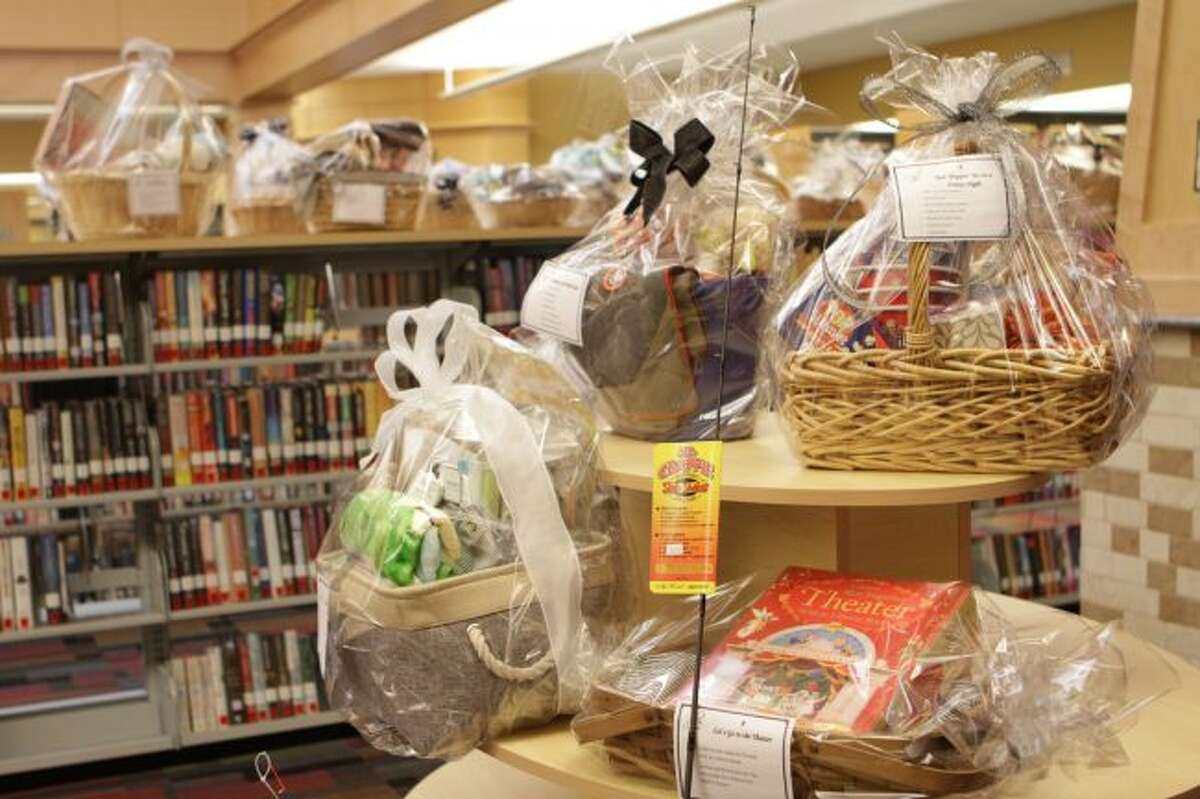 Baskets full of prizes donated by different businesses and individuals are currently on display at the Morton Township Library. During the annual Champagne and Chocolate Gala on Friday, attendees will have a chance to bid on these silent auction items, as well as live auction items. (Pioneer photo/Meghan Gunther-Haas)
