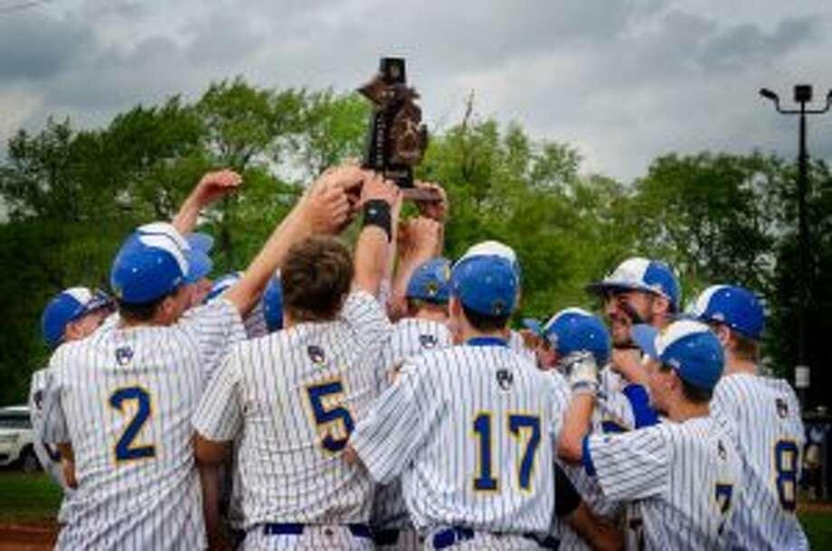 Evart's baseball team celebrates a district crown.