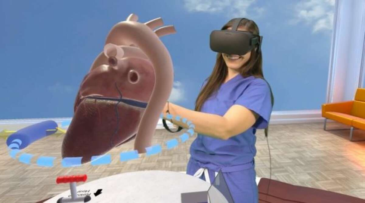 Alyssa Giacalone, a physician assistant at Lucile Packard Children's Hospital Stanford, uses the Stanford Virtual Heart. (AMERICAN HEART ASSOCIATION NEWS Photo courtesy of David Sarno)