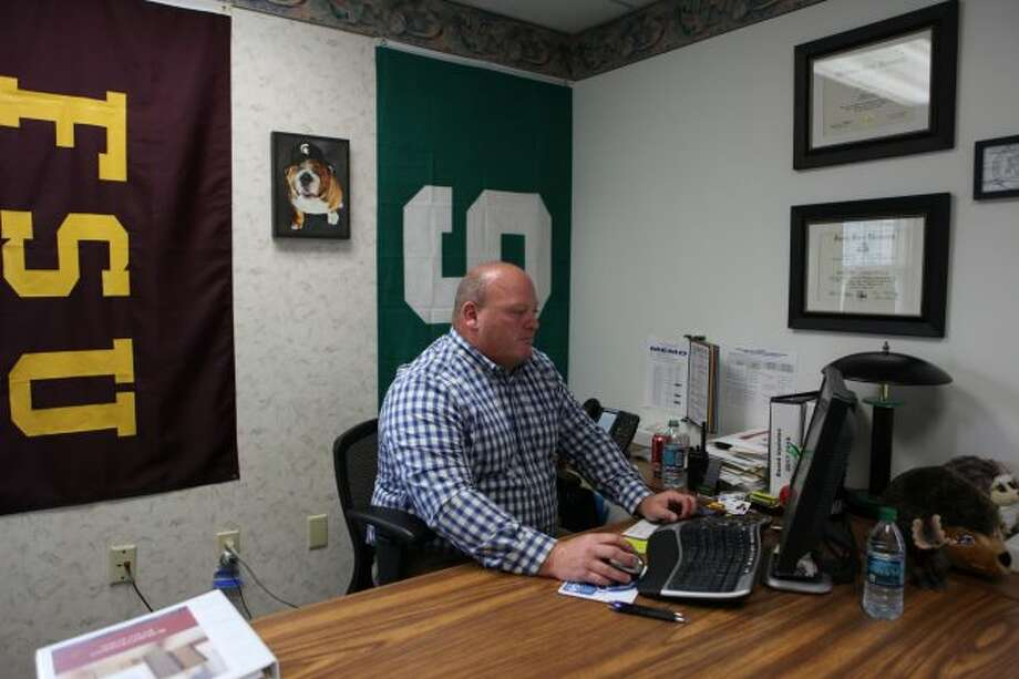 Mark Klumpp works at his computer as he balances the interim and assistant superintendent of the Mecosta-Osceola Intermediate School District. Klumpp was named interim after Curtis Finch, previous superintendent, left to take on a new position in Arizona. (Pioneer photo/Meghan Haas)