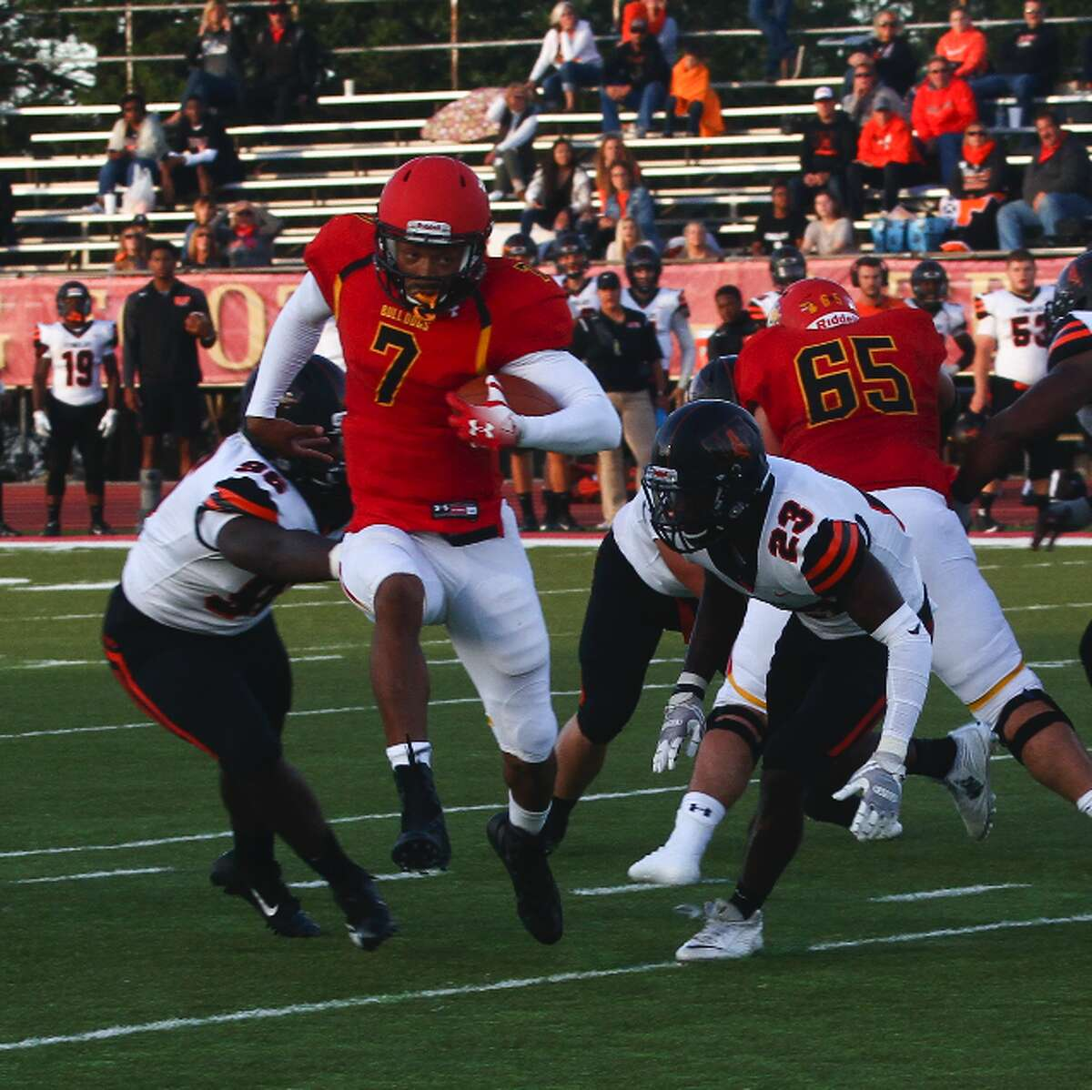 Ferris State quarterback Jayru Campbell escapes would-be tacklers during Saturday's game. (Pioneer photo/Maxwell Harden)