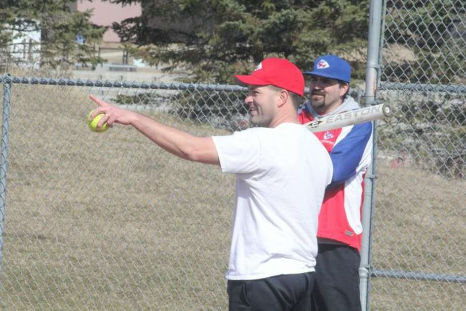 Chippewa Hills coach D.J. Newman leads a Warrior practice.