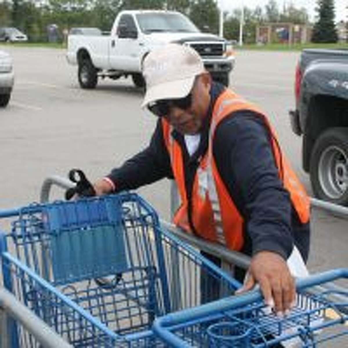 Levi Arrington, 45, of Big Rapids, works as a cart-pusher at the local Meijer outlet. He is also an advocate for people such as himself, who suffer from cognitive impairments. (Pioneer photo/Tim Rath)