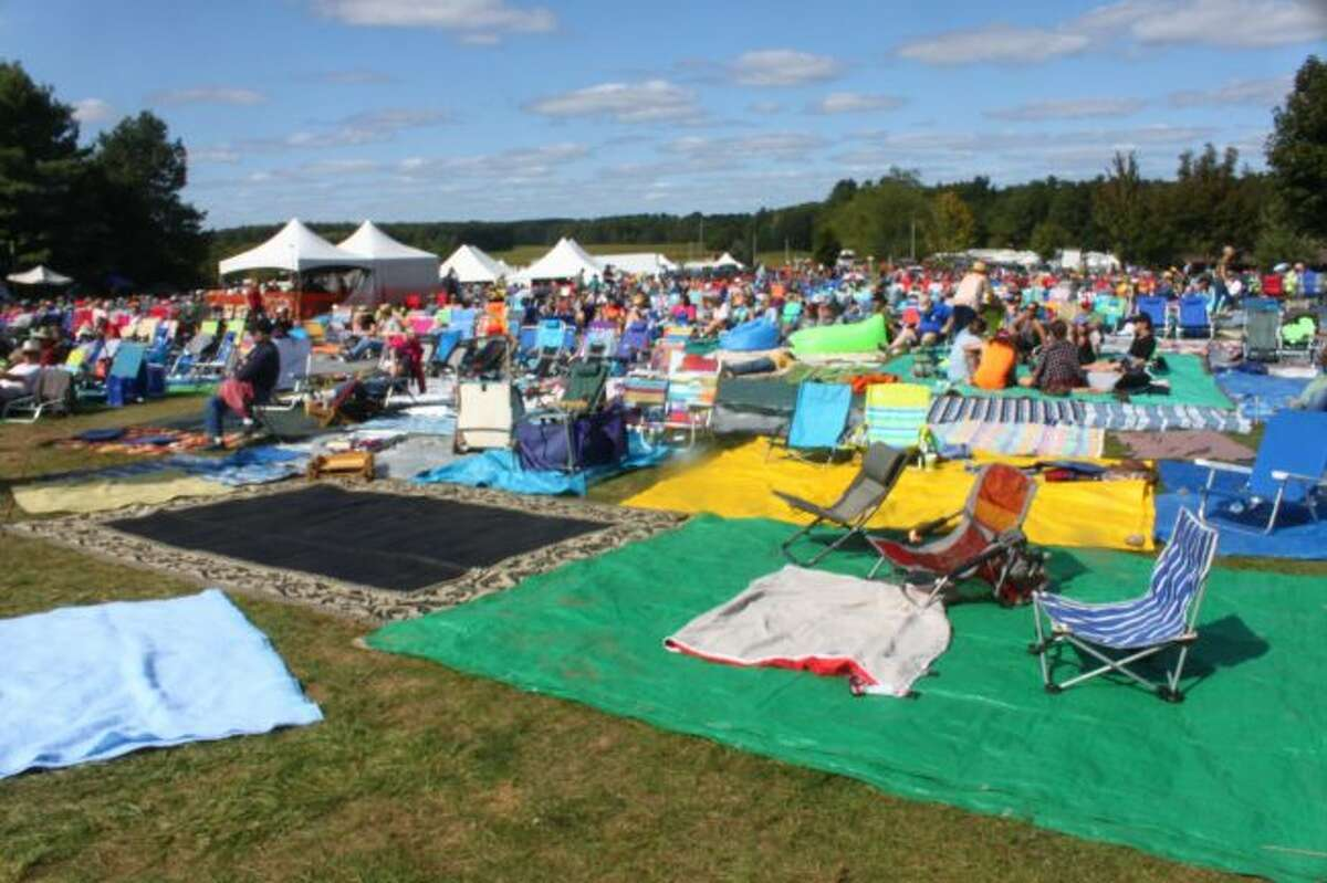 Festival-goers had picnic blankets and lawn chairs spread throughout the field near the main stage. (Pioneer photo/Shanna Avery)