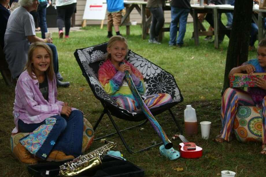 Groups of kids showed off their musical talent while waiting for main stage performers. Other people ate, shopped and danced. (Pioneer photo/ Catherine Sweeney)
