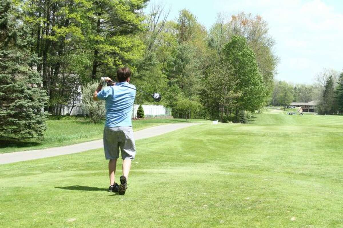 DRIVE: Anthony Vissman looks for his golf ball after swinging through his shot.