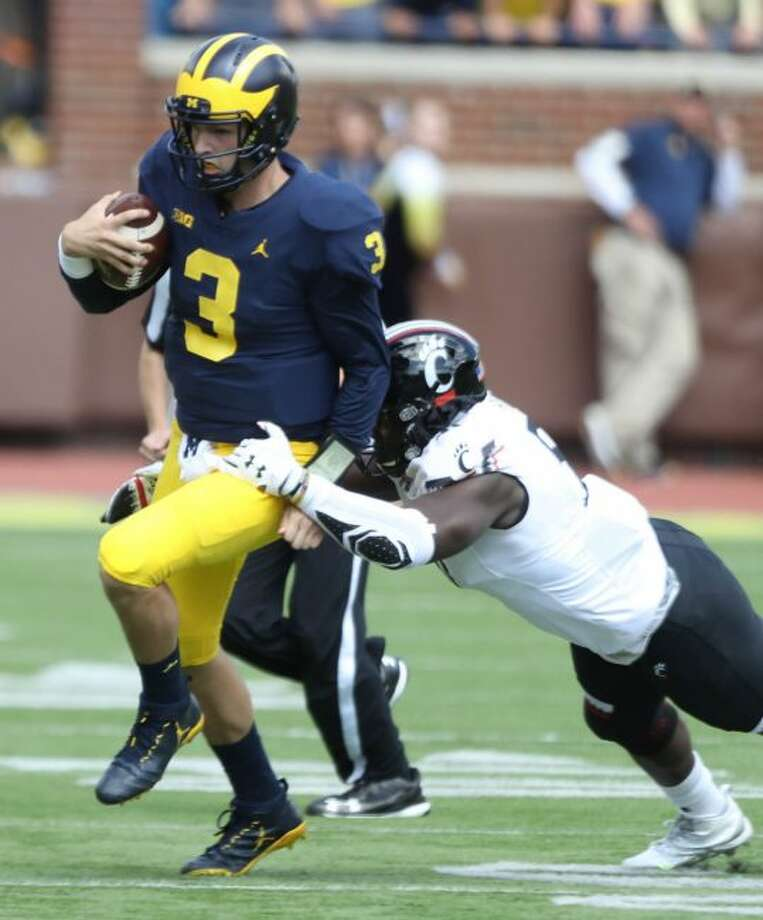 Michigan's Michigan's Wilton Speight picks up yardage during the second quarter against Cincinnati on Saturday, Sept. 9, 2017, at Michigan Stadium in Ann Arbor, Mich. The host Wolverines won, 36-14. (Kirthmon F. Dozier/Detroit Free Press/TNS)