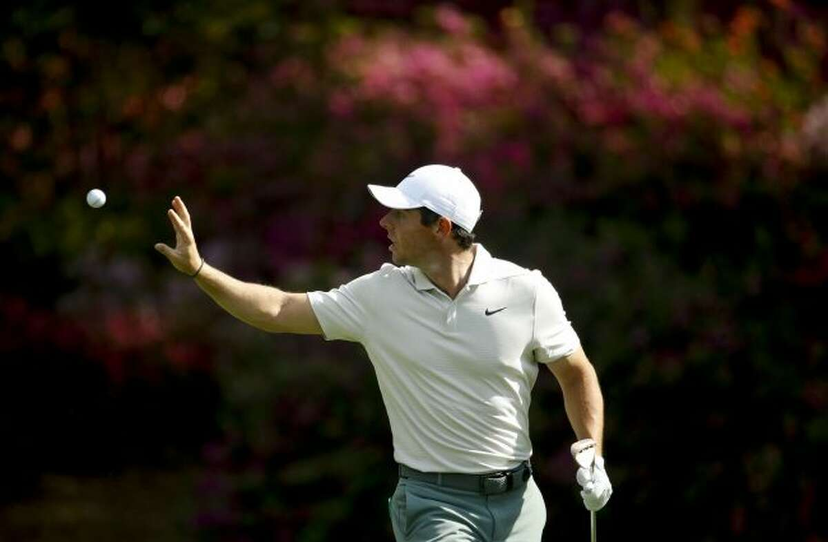 Rory McIlroy, of Northern Ireland, catches a ball from his caddie on the 13th hole during practice for the Masters golf tournament at Augusta National Golf Club, Tuesday, April 3, 2018, in Augusta, Ga. (AP Photo/Charlie Riedel)