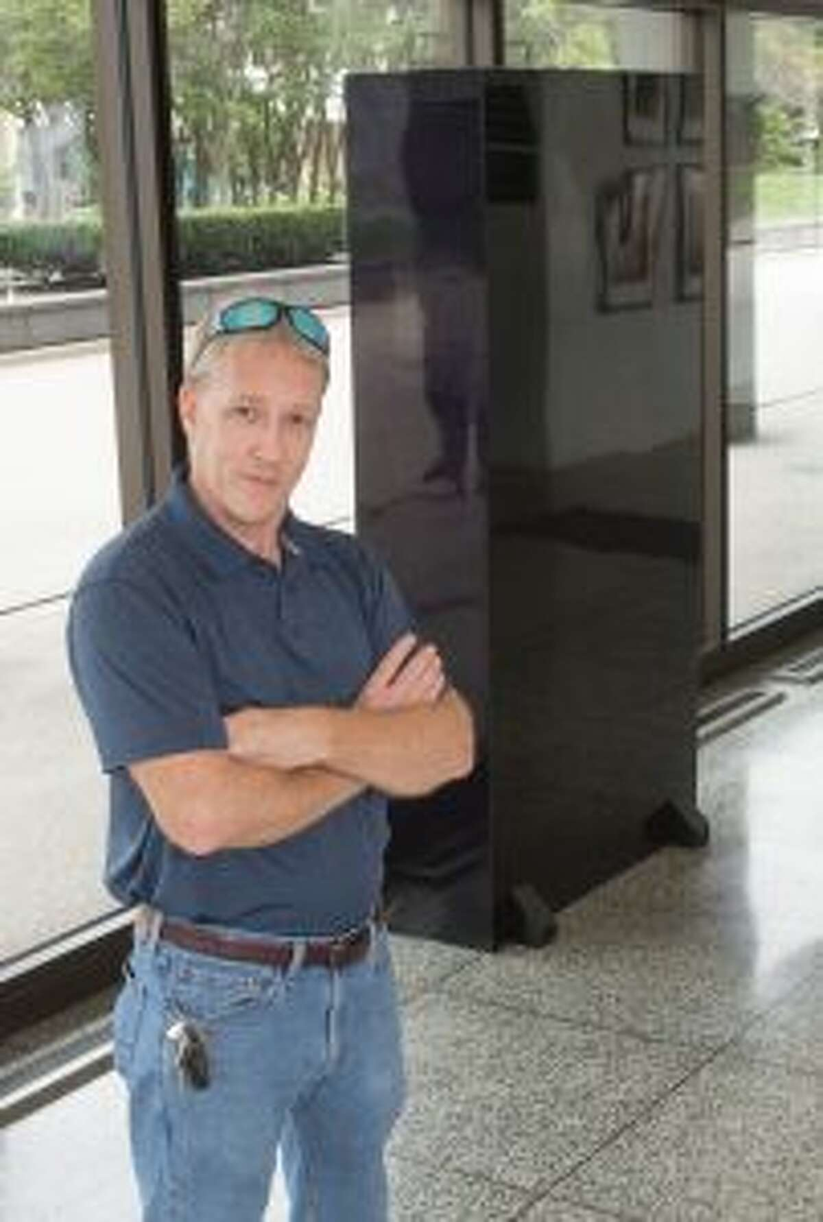 Richard Piippo, of Big Rapids, poses beside his work