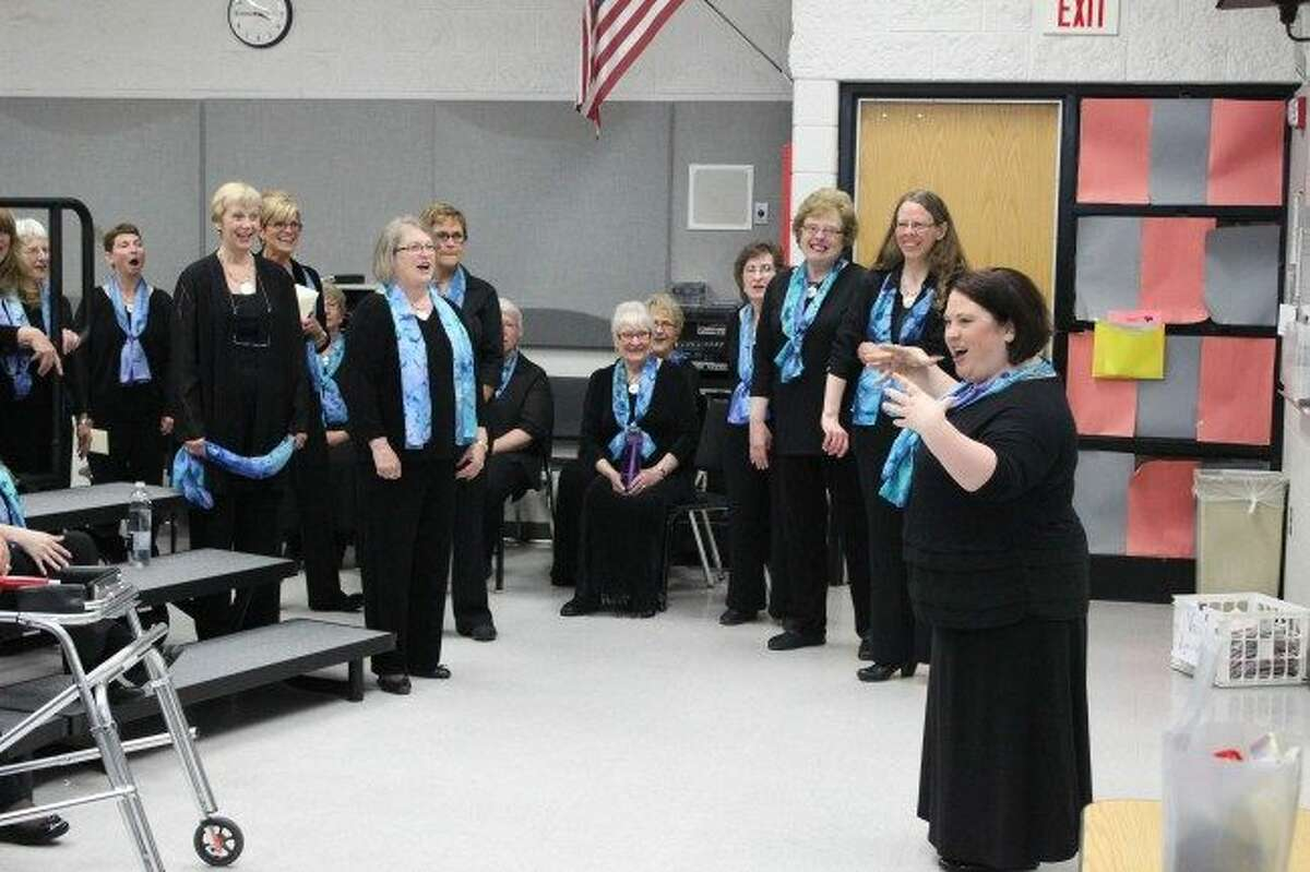 Members of the Big Rapids women's choir group Voca Lyrica prepare for one of their annual concerts in 2016. This year's holiday concert,