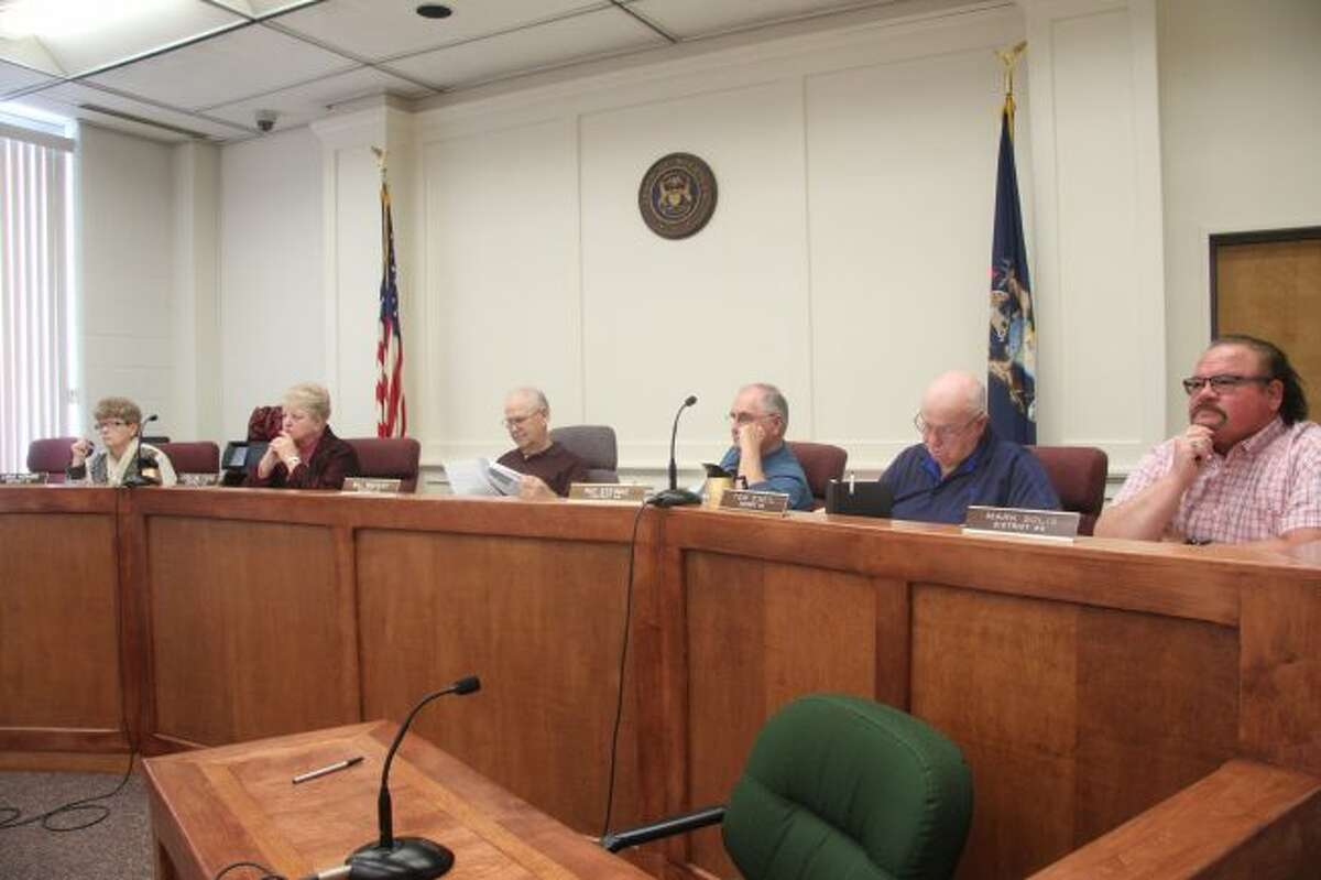 Mecosta County Commissioners listen to a presentation during Thursday's board meeting. During the meeting, officials approved two millage renewal requests for the Aug. 7 primary election during the meeting. (Pioneer photo/Brandon Fountain)