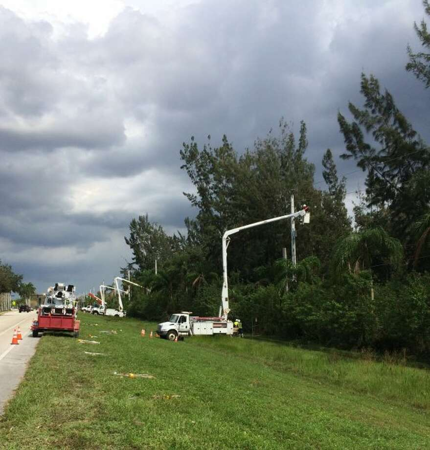Crew members of journeymen linemen from Utility Supply and Construction Company are helping in utility restoration efforts in areas of Florida impacted by Hurricane Irma. Mobilized days prior to the hurricane's landfall on Sunday, the crews are working on thousands of power lines and installing new poles. (Courtesy photo/The Hydaker-Wheatlake Company)