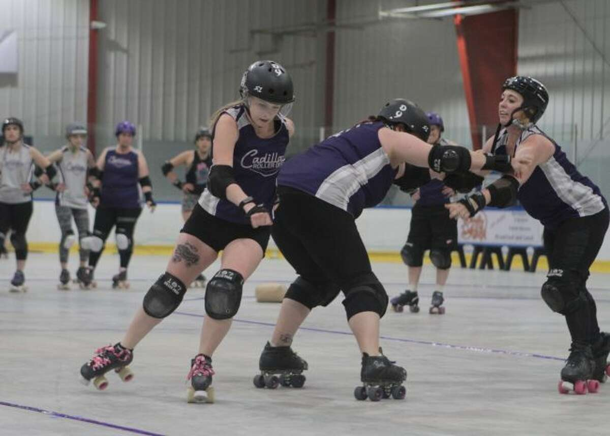 Members of the Cadillac DeVillains practice for their first home bout at 6 p.m. on Saturday, June 15, at the Wexford Civic Center, 1320 N. Mitchell St., Cadillac. Doors open for the event at 5 p.m. (Pioneer photo/Taylor Fussman)