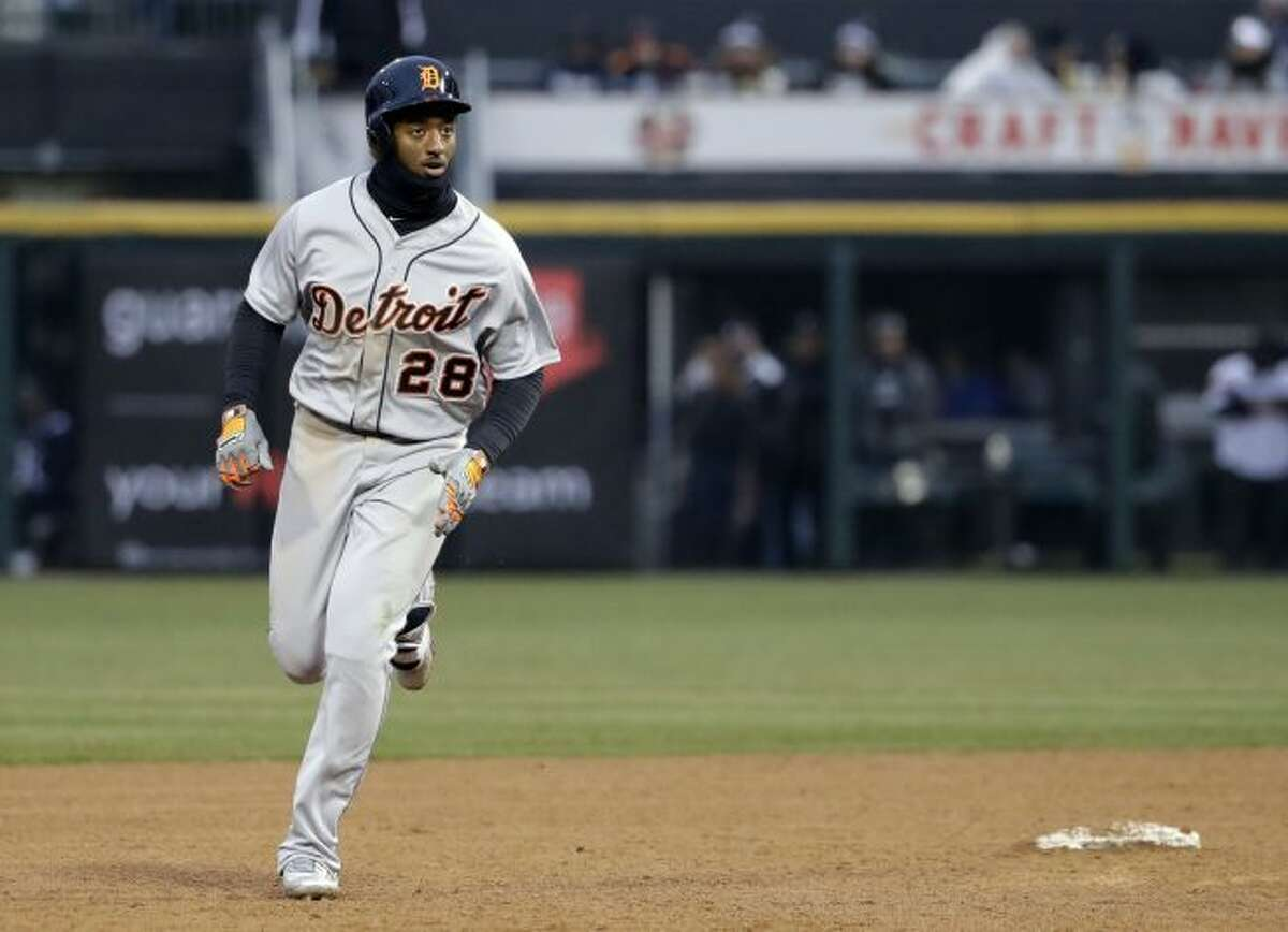 Detroit Tigers' Niko Goodrum rounds the bases after hitting a two-run home run against the Chicago White Sox during the ninth inning of a baseball game Thursday, April 5, 2018, in Chicago. The Tigers won 9-7. (AP Photo/Nam Y. Huh)