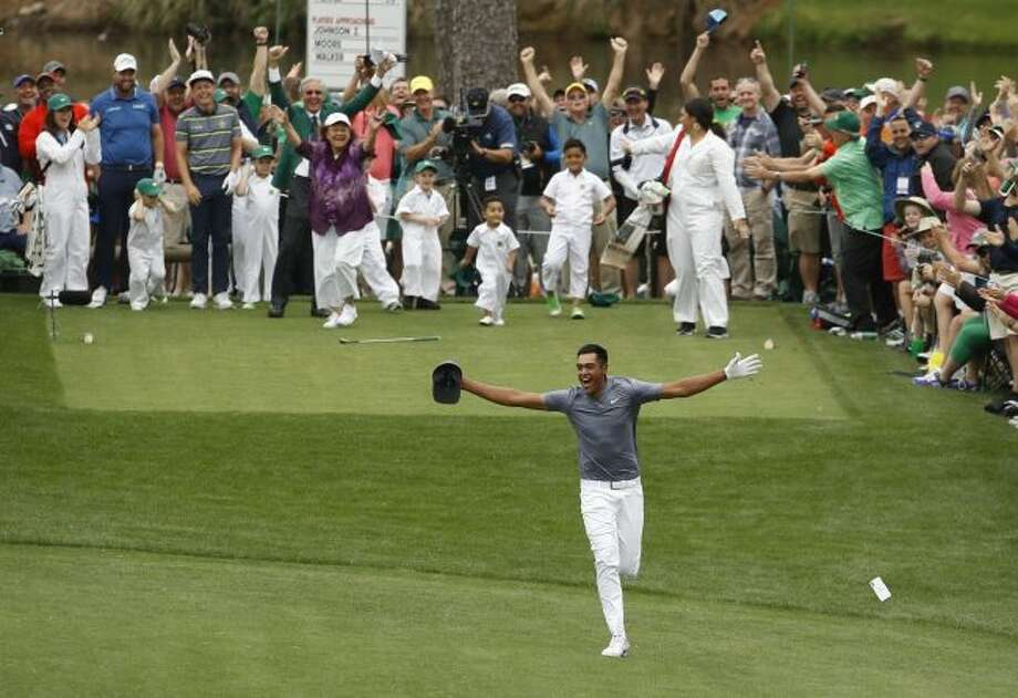 Tony Finau reacts after hitting a hole in one on the seventh hole during the par three competition at the Masters golf tournament Wednesday, April 4, 2018, in Augusta, Ga. (AP Photo/Charlie Riedel)
