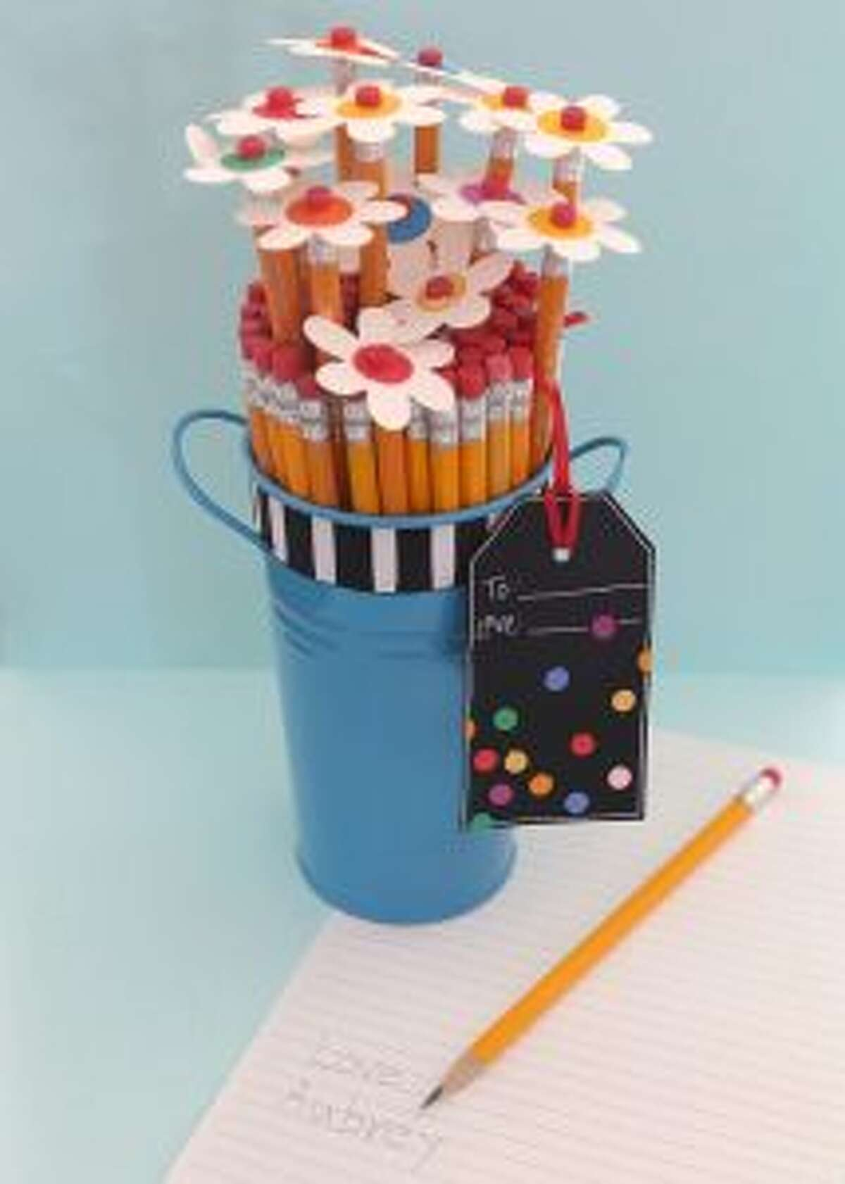 When you head off to the store to purchase school supplies for your kids, why not grab some extras to donate to the class and set the tone for a great school year? (Cara Mariano)