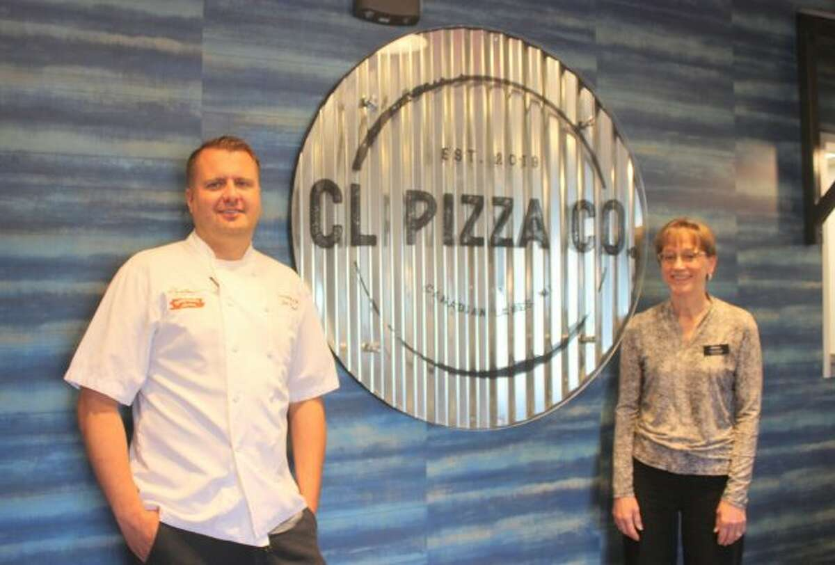 From left, Jim Wood and Una Ebert pose inside the new CL Pizza Co. and Dockside Ice Cream restaurant, located in the heart of Canadian Lakes. Ebert, the general manager of the restaurants, said she hopes to open by July. (Pioneer photo/Tim Rath)