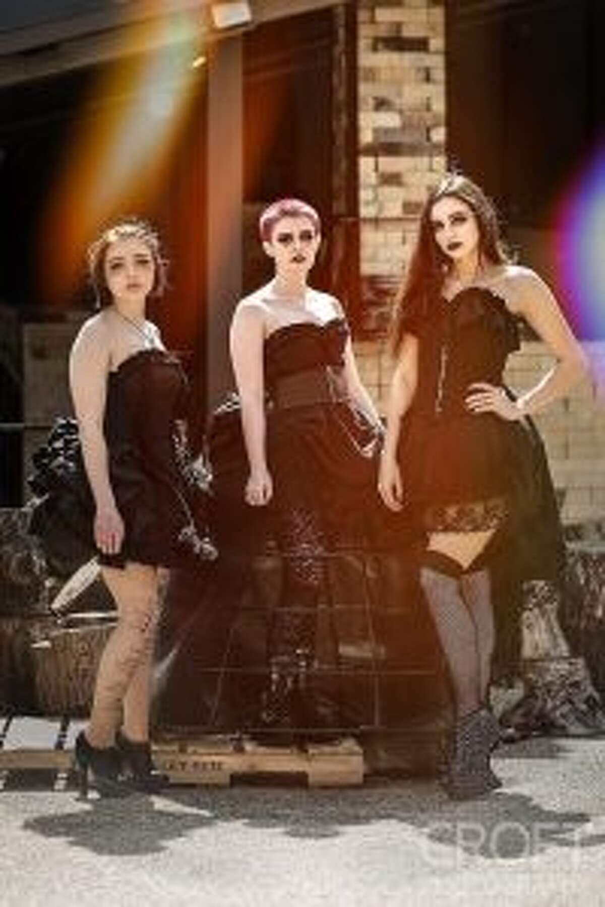 A total of three of Larson's collections will be displayed during the show, including one entitled Darkness Encompassing, which she describes as having a dark gothic theme. Modeling this collection are Cassandra Scouten, Victoria Vitale and Natasha Raquepaw.