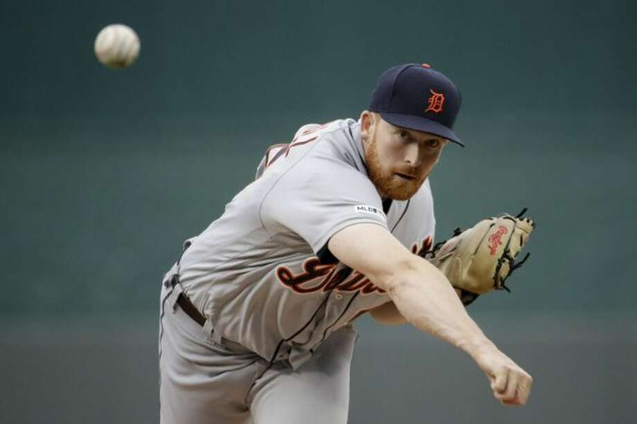 Detroit Tigers starting pitcher Spencer Turnbull throws during the first inning of a baseball game against the Kansas City Royals Tuesday, June 11, 2019, in Kansas City, Mo. (AP Photo/Charlie Riedel)