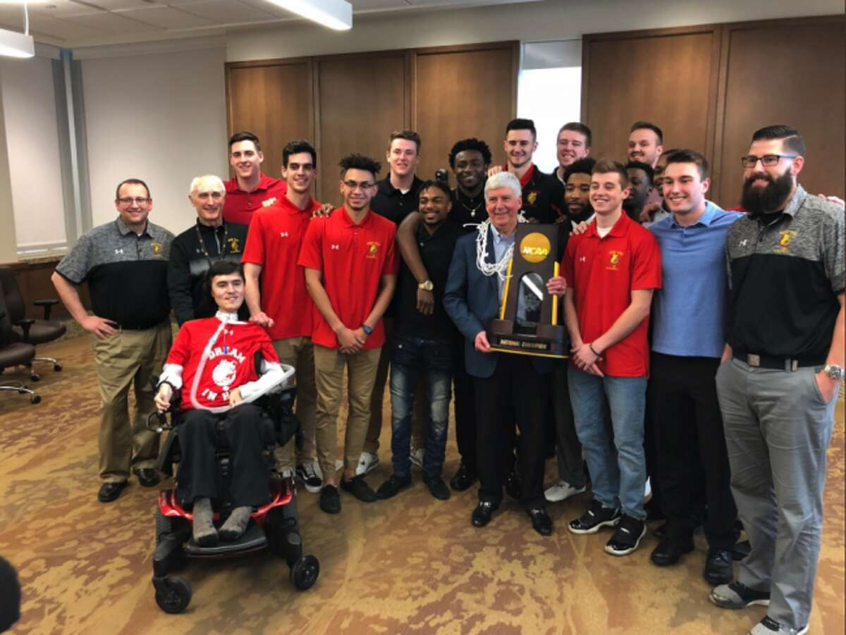 The Ferris State men's basketball team poses for a photo with Michigan governor Rick Snyder on Thursday. (Photo courtesy of Ferris State Athletics)