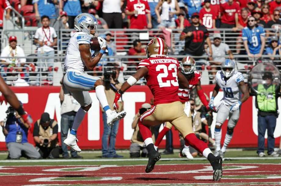 Detroit Lions wide receiver Marvin Jones Jr. catches the ball for a touchdown as San Francisco 49ers cornerback Ahkello Witherspoon looks on during the second half of an NFL football game in Santa Clara, Calif. (AP Photo/Tony Avelar)