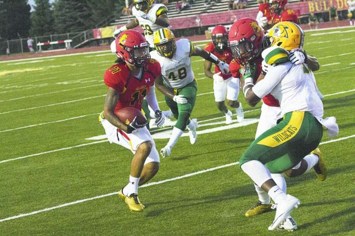 Ferris State receiver Lindrell Mitchell (11) evades a Northern Michigan defender on his way to the end zone during Saturday's game at Top Taggart Field. (Pioneer photo/Maxwell Harden)