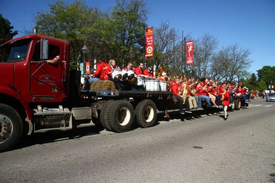 Members of the Ferris State University band ride on a trailer during last year's FSU homecoming parade. This year, multiple homecoming parades and games are scheduled through Friday, Oct. 5. (Pioneer file photo)
