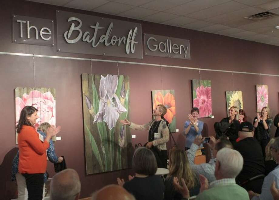 Members of the Artworks board of directors unveiled the new sign for The Batdorff Gallery during a gallery dedication and renaming ceremony Thursday evening. (Pioneer photos/Taylor Fussman)