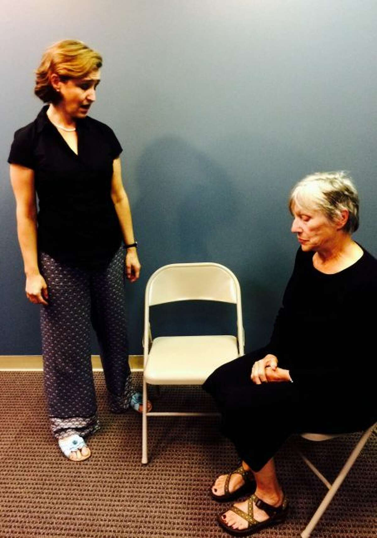 """Kelley Samuels (left) and Rose Anne Shansky rehearse a scene from """"You Owe Me."""" (Courtesy photo)"""