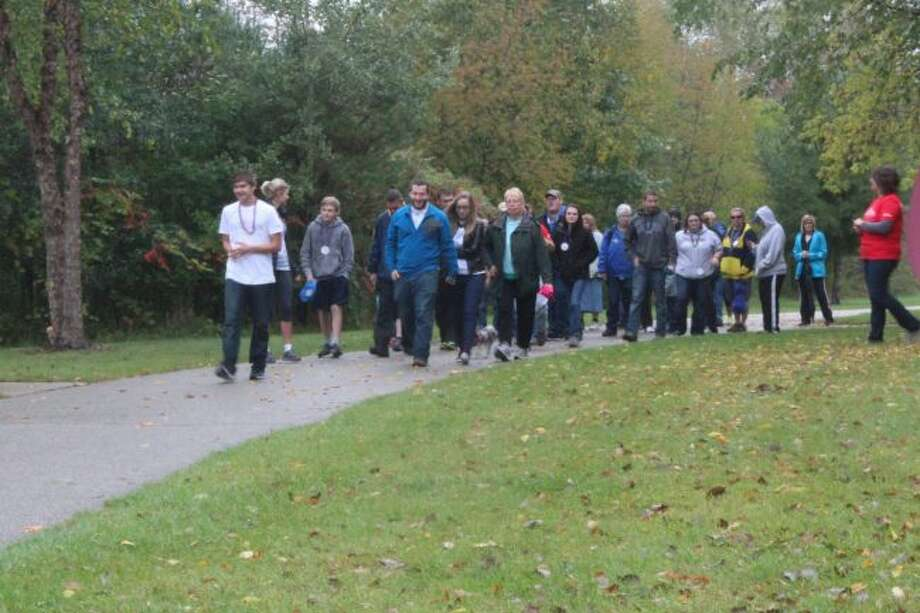 The seventh annual Out of the Darkness Walk to benefit the American Foundation of Suicide Prevention will take place on Saturday, Sept. 23, at Northend Riverside Park in Big Rapids. (Pioneer file photo)