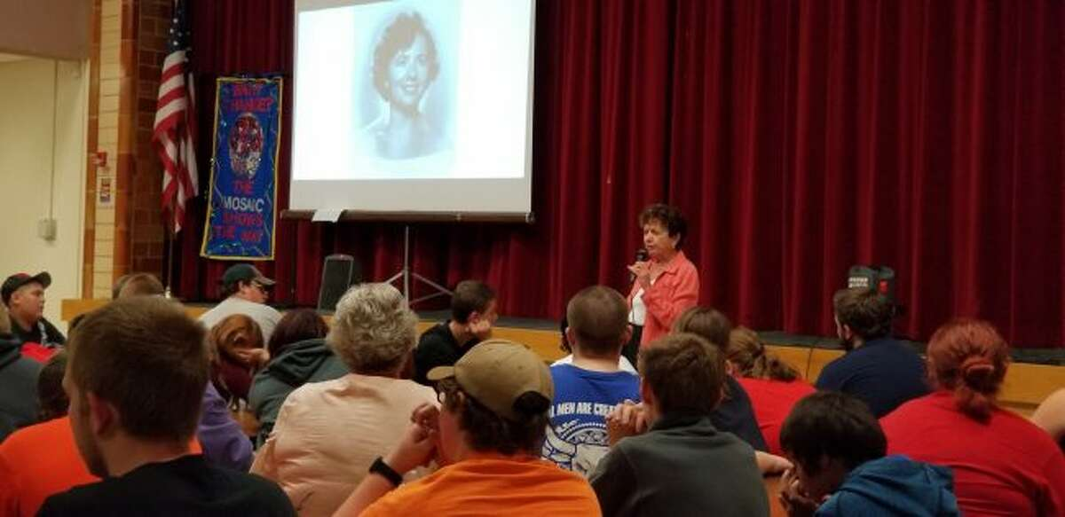 """Holocaust survivor Irene Miller talks with Chippewa Hills Mosaic School students about her experiences during WWII and what she learned from her time in """"no man's land,"""" labor camps, and orphanages, and while immigrating to different countries. (Pioneer photo/Meghan Gunther-Haas)"""