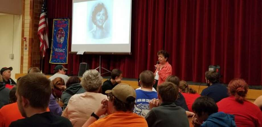 "Holocaust survivor Irene Miller talks with Chippewa Hills Mosaic School students about her experiences during WWII and what she learned from her time in ""no man's land,"" labor camps, and orphanages, and while immigrating to different countries. (Pioneer photo/Meghan Gunther-Haas)"