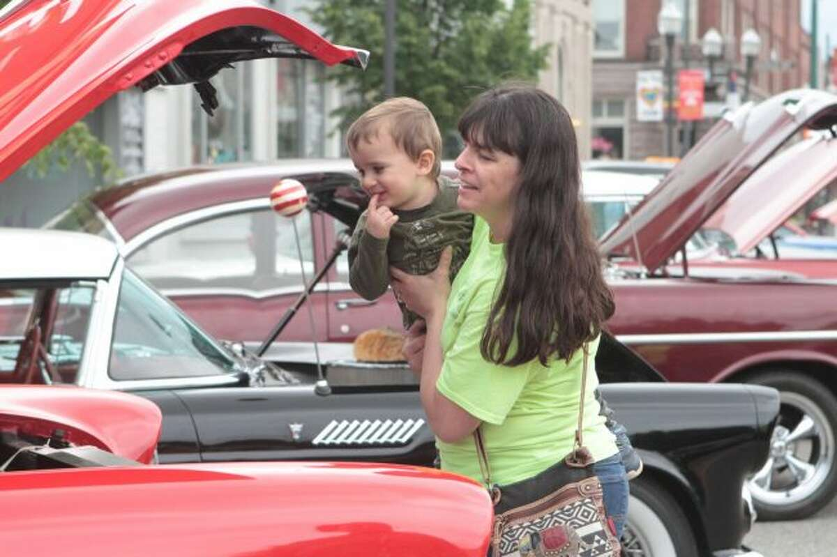 Evie Lankton and her grandson, Keegan Miller, were among the crowd of car enthusiasts in downtown Big Rapids this weekend.