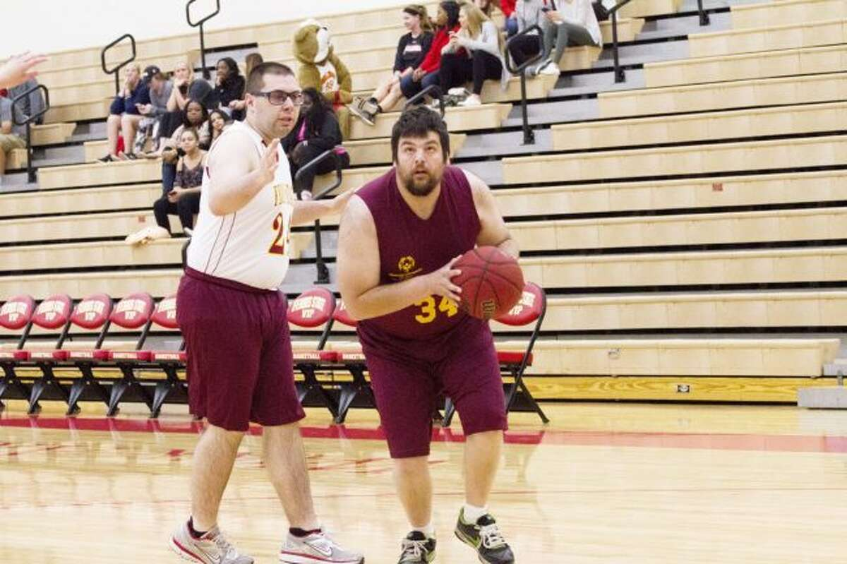 Special Olympics athletes compete during last year's Heart to Heart Hand in Hand Special Olympics basketball game. All funds go to the Special Olympics Area 5 basketball team. (Pioneer file photo)