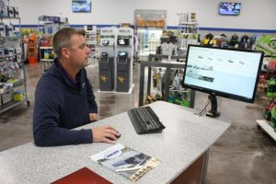 Lakeside Motor Sports marine division manager Neil Maneke explains how staffers can help customers design custom watercrafts to purchase online on Wednesday. Lakeside recently unveiled its new, 50,000-square-foot showroom and service facility. (Pioneer photo/Tim Rath)