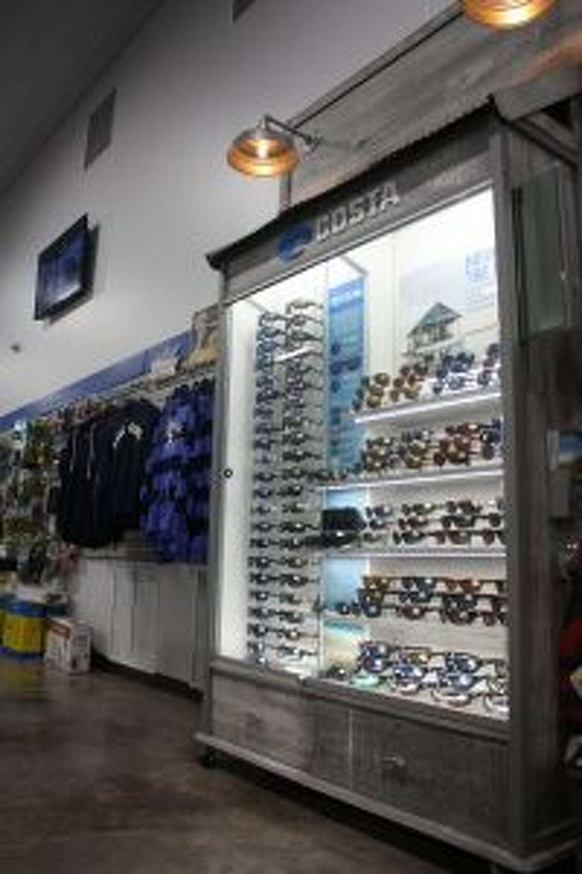 A selection of accessories for sale at Lakeside Motor Sports, including sunglasses and clothing, are pictured Wednesday. (pioneer photo/Tim Rath)