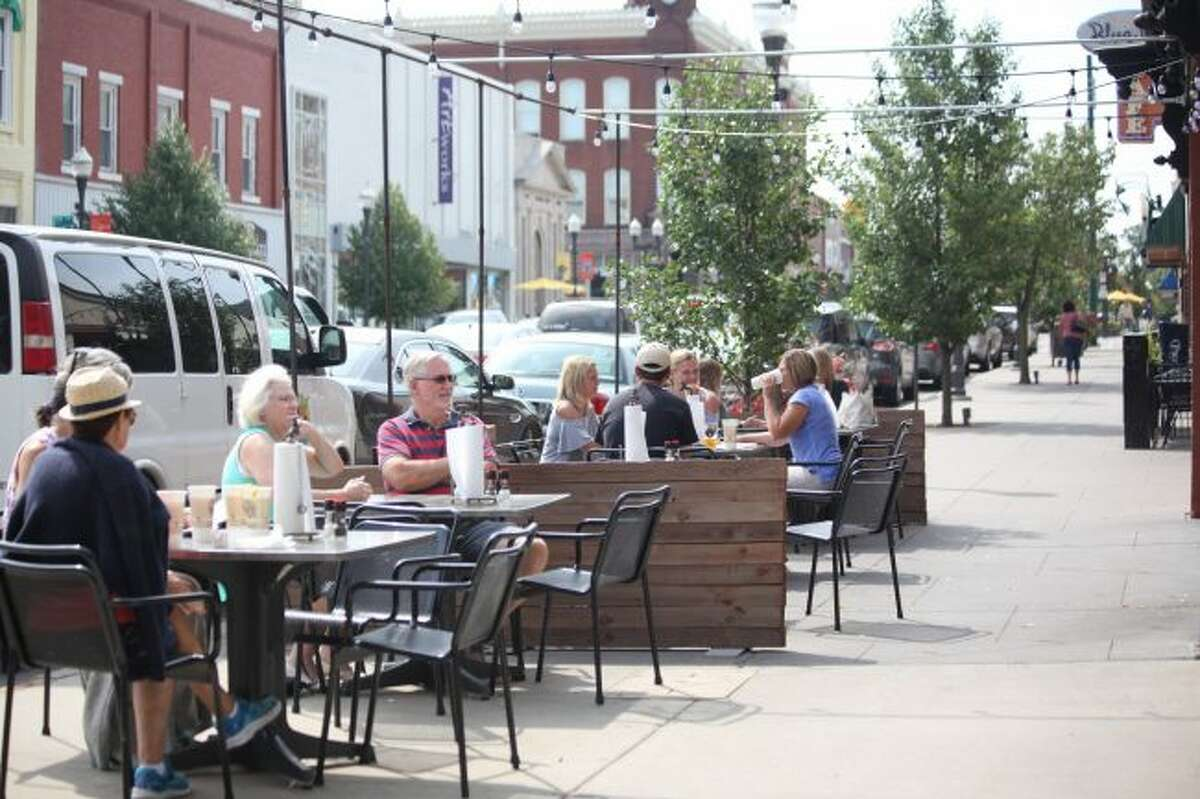 Local businesses like Raven Brewing and Barbecue and Blue Cow Cafe experience an increase in business from the weekly Pocket Park Concert Series throughout the summer. As the series comes to an end for the season this year, employees only expect to see a slight decrease in customers on Friday afternoons. (Pioneer file photo)