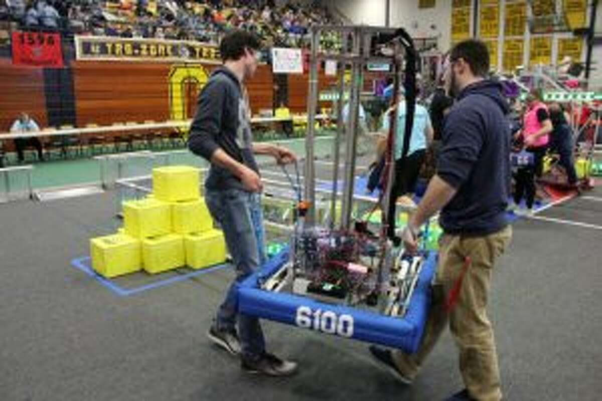 Members of the Morley Stanwood Mohawks team carry their robot onto the competition floor during the event in Traverse City. The team and their robot will be on another competition floor this weekend during the state championships. (Pioneer file photo)
