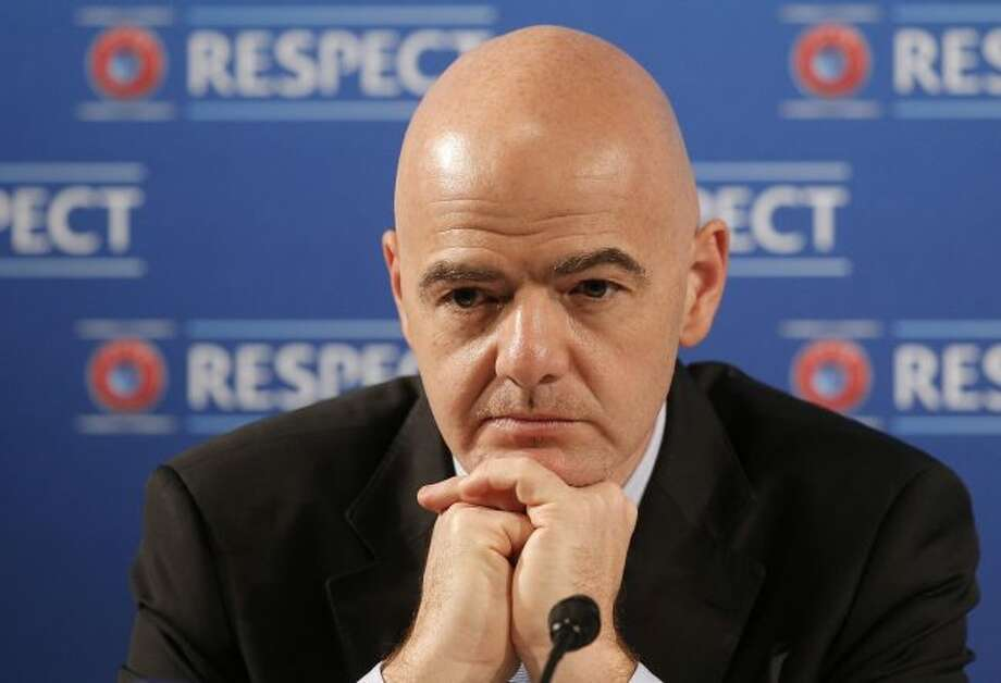 In this file photo dated Saturday, Feb 22, 2014, Gianni Infantino gestures during a press conference at the Acropolis Convention Centre in Nice, southeastern France. FIFA President Gianni Infantino wants to team up with American, Chinese and Saudi Arabian interests to launch an expanded 24-team Club World Cup, played every four years starting in 2021, and a two-yearly global competition for national teams. (AP Photo/Lionel Cironneau, FILE)