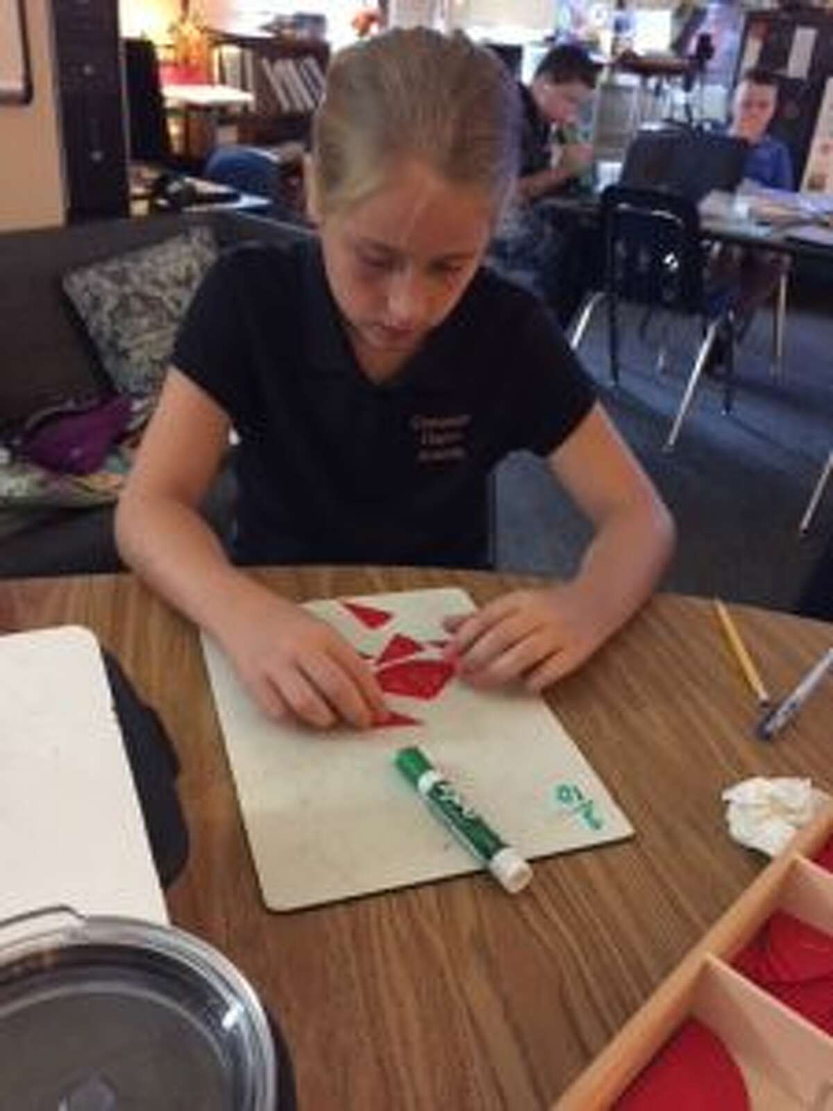 A sixth-grader uses hands-on tools while learning about fractions in Diana Kreh's Montessori-inspired classroom at Crossroads Charter Academy.