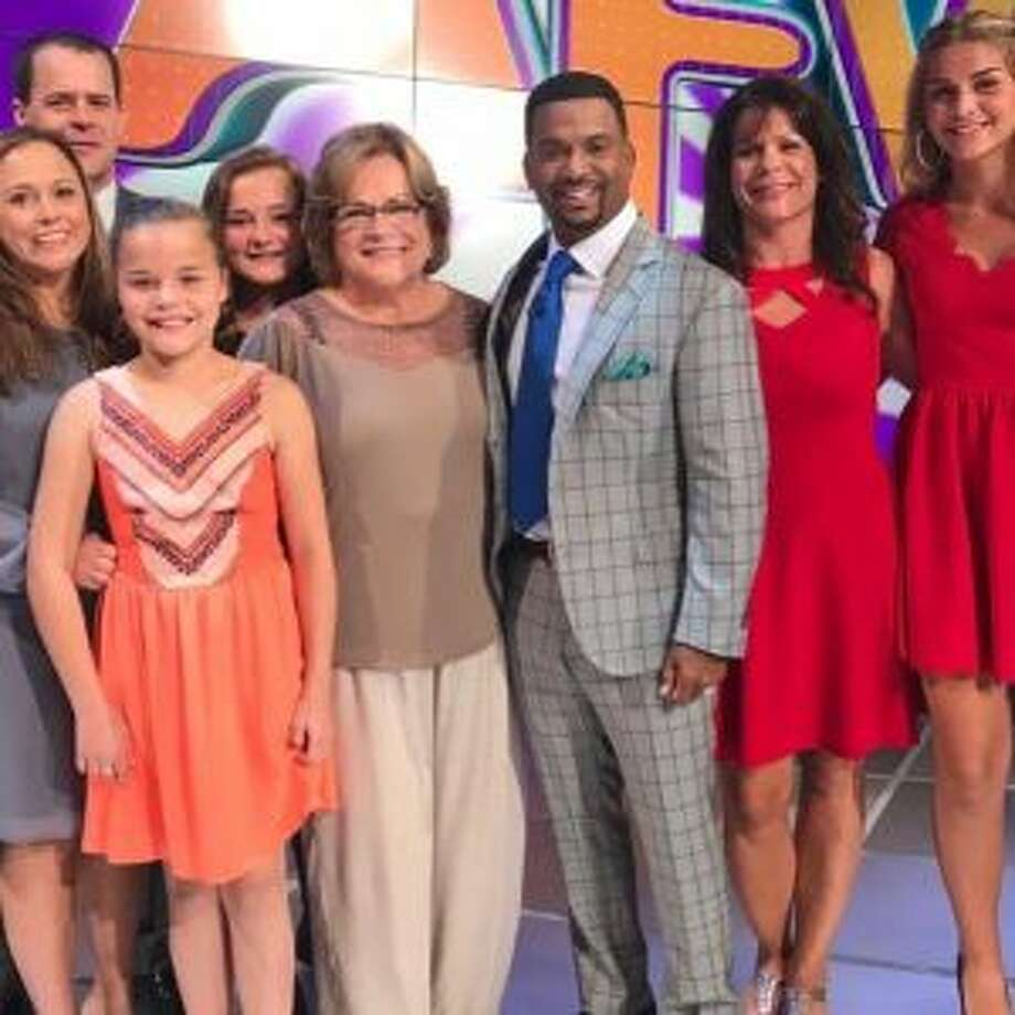 """Cheryl DePew, of Big Rapids, stands surrounded by her family beside """"America's Funniest Home Videos"""" host Alfonson Ribeiro during a taping of the show in Los Angeles last week. DePew will appear on """"AFV"""" next month. (Courtesy photo)"""