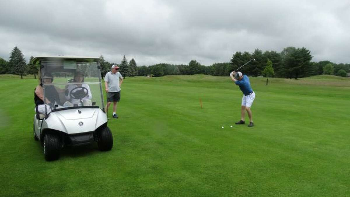 Area residents participate in the 2018 Mecosta County Habitat for Humanity golf open. This year's event will begin at 10 a.m. on Wednesday, June 26, at the Royal Golf Course at Canadian Lakes. (Pioneer file photo)