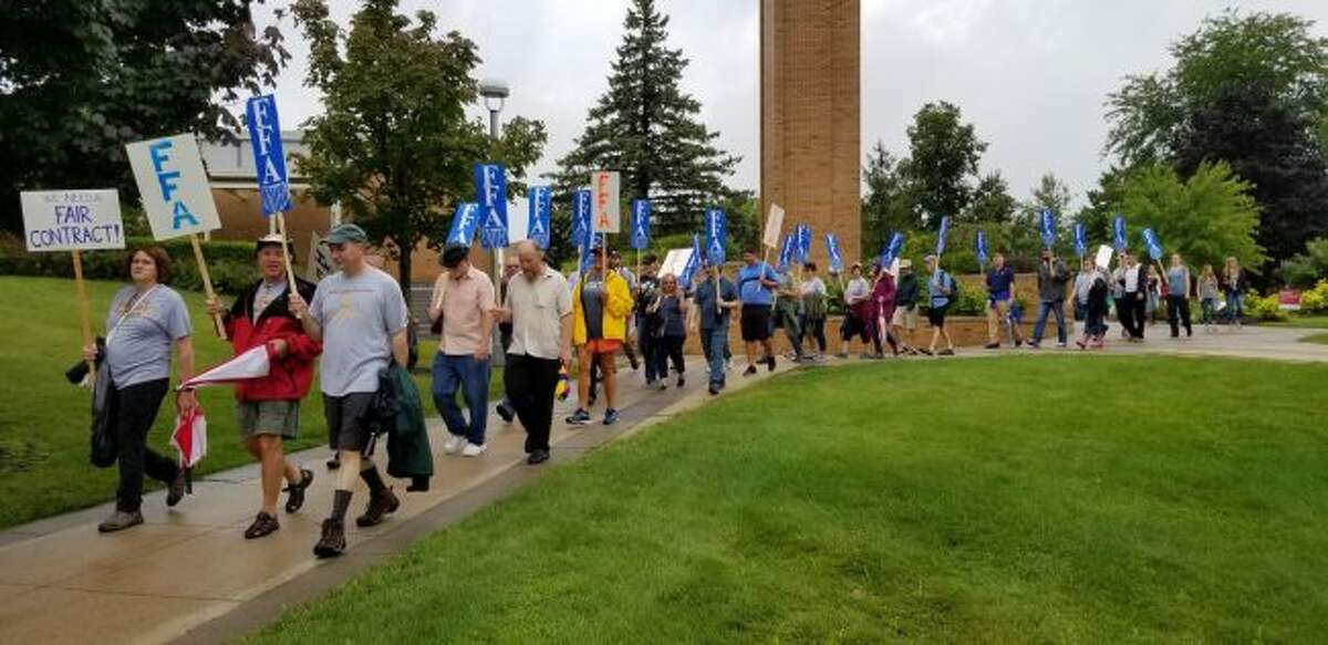 Members of the Ferris Faculty Association march across Ferris State University's campus on the first day of the fall semester. On Tuesday and Wednesday, FFA members can consider participating in a vote of no confidence against President David Eisler. (Pioneer file photo)