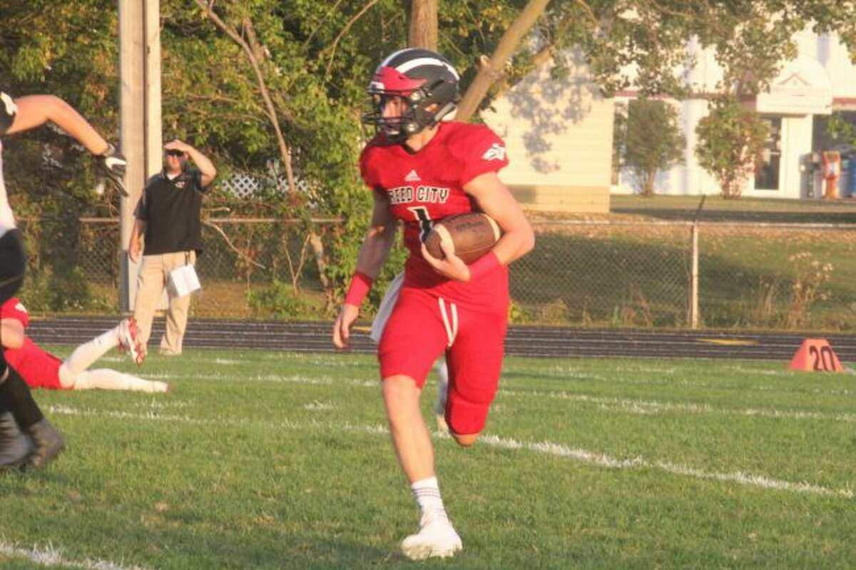 Reed City quarterback Jackson Price and his team will be in the playoffs on Friday at home. (File photo)